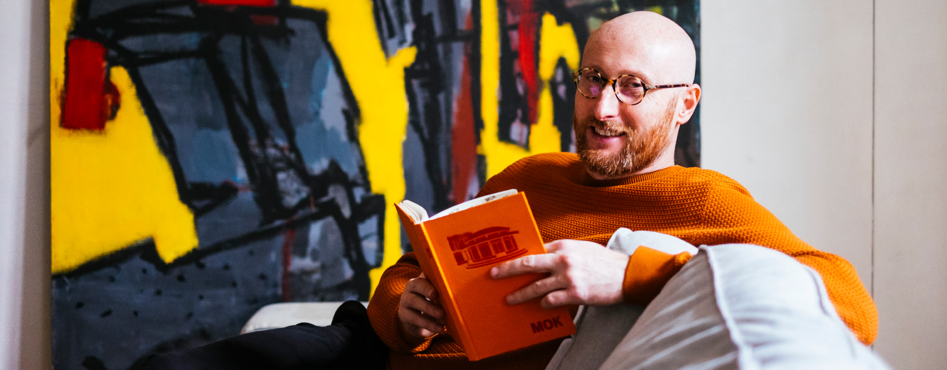 man reading on a couch